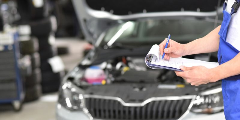 service and inspection of a car in a workshop - mechanic inspects the technology of a vehicle for function and safety
