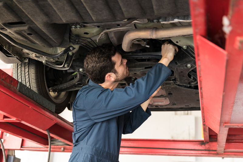 Car Servicing Belfast | Male Technician Servicing Car In Repair Shop | Ards Brake & Clutch Service Centre Newtonards